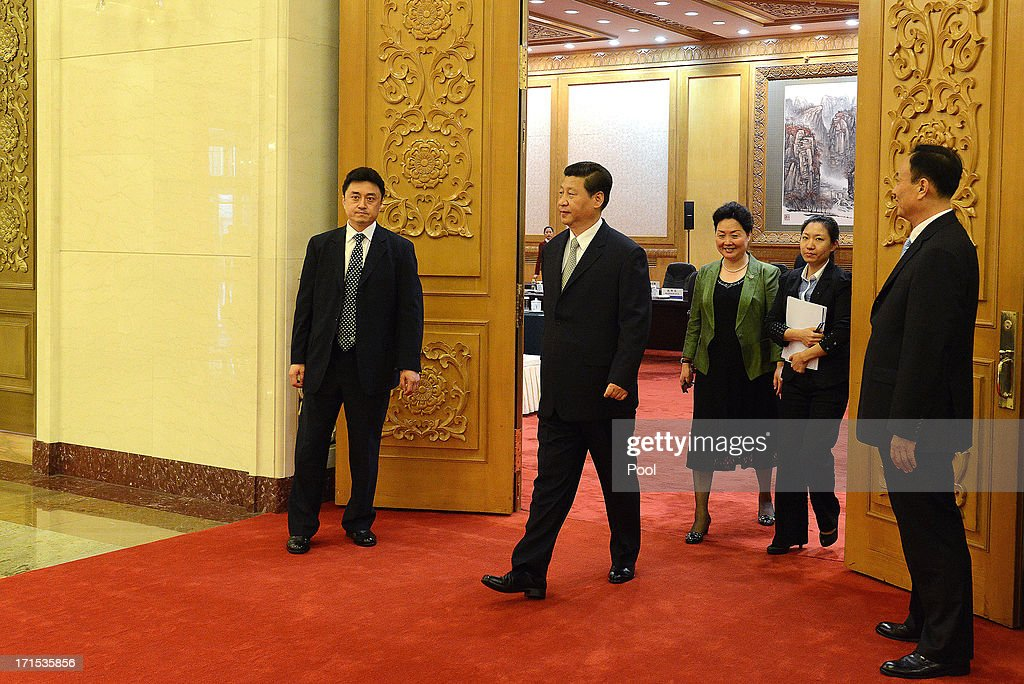 Chinese President Xi Jinping prepares to meet Suriname President Desi Bouterse at the Great Hall of the People on Jun 26, 2013 in Beijing, China. Desi Bouterse is on a visit to China from Jun 24.