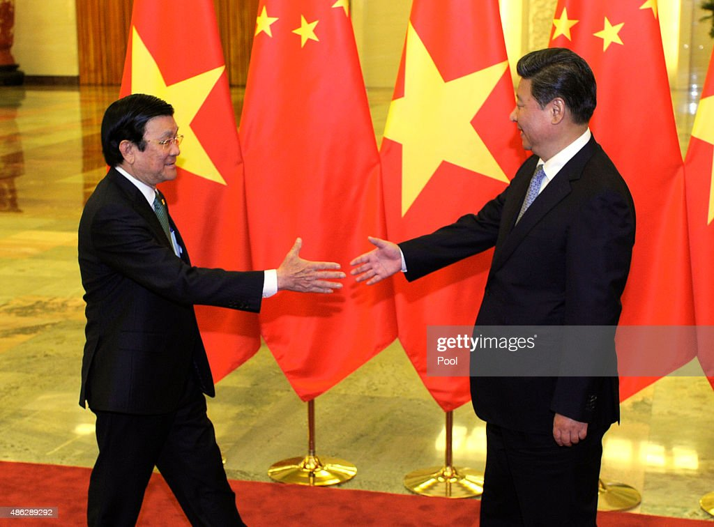 Chinese President <a gi-track='captionPersonalityLinkClicked' href=/galleries/search?phrase=Xi+Jinping&family=editorial&specificpeople=2598986 ng-click='$event.stopPropagation()'>Xi Jinping</a> (right), prepares to shake hands with Vietnamese President Truong Tan Sang before their meeting at the Great Hall of the People on September 3, 2015 in Beijing, China. China is marking the 70th anniversary of the end of World War II and its role in defeating Japan with a new national holiday and a military parade in Beijing.