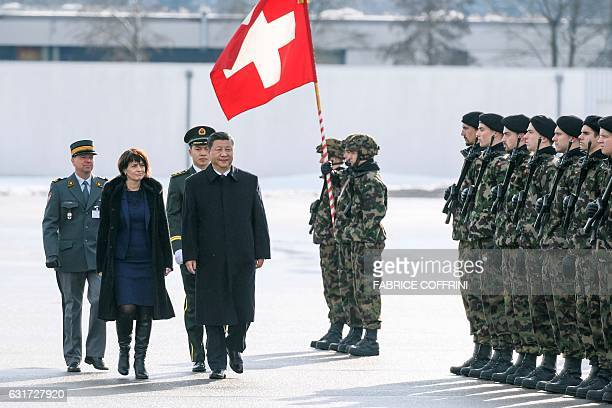 Chinese president Xi Jinping review the guard of honor next to Swiss President Doris Leuthard upon his arrival for a state visit on January 15 2017...