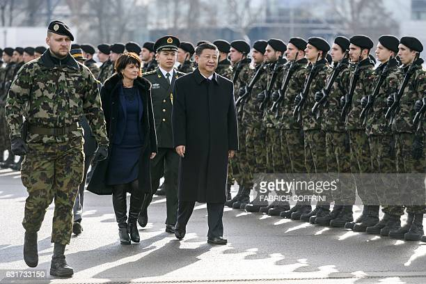 Chinese president Xi Jinping review the guard of honour next to Swiss president Doris Leuthard during the welcome ceremony upon his arrival for a...