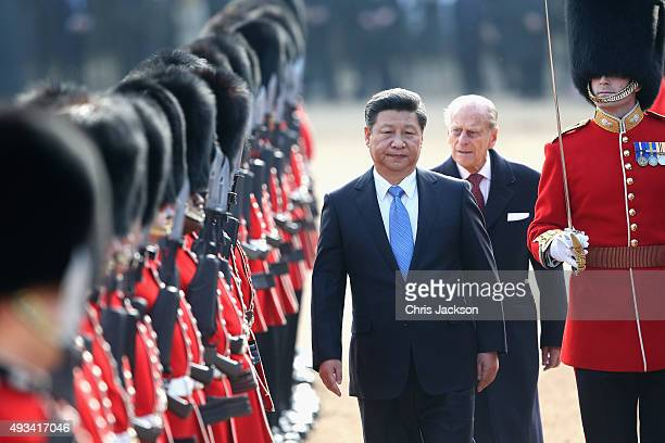 Chinese President Xi Jinping reviews a Guard of Honour on Horseguards Parade during the Official Ceremonial Welcome for the Chinese State Visit on...