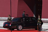 Chinese President Xi Jinping rides under Tiananmen rostrum after reviewing troops from a car during a military parade at Tiananmen Square in Beijing...