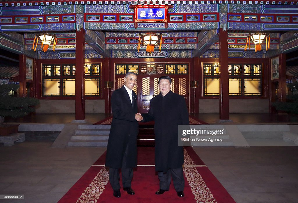 Chinese President Xi Jinping right meets with US President Barack Obama at the Zhongnanhai leadership compound in Beijing capital of China Nov 11...