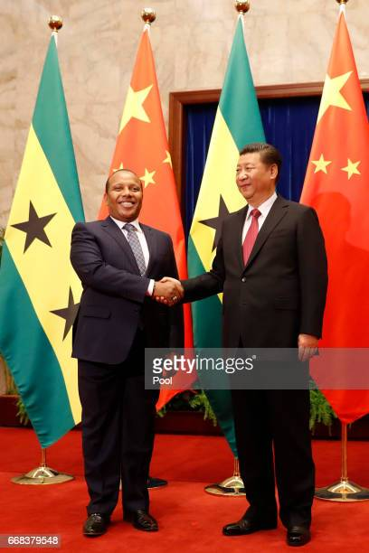 Chinese President Xi Jinping right shakes hands with Sao Tomean Prime Minister Patrice Trovoada at the Great Hall of People on Friday April 14 2017...