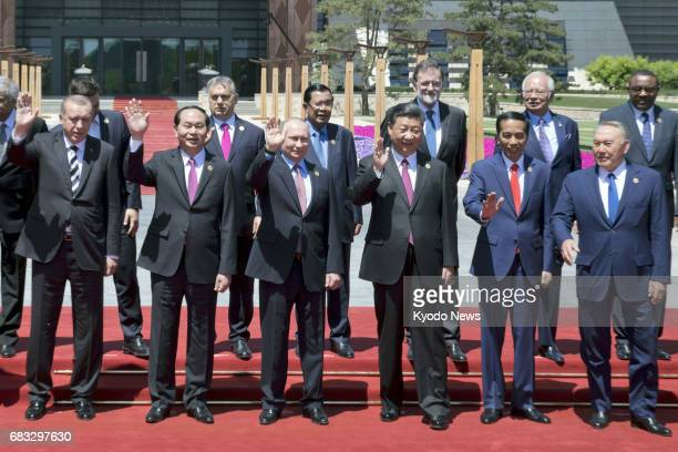 Chinese President Xi Jinping Russian President Vladimir Putin and other national leaders wave as they gather for a group photo session in Beijing on...