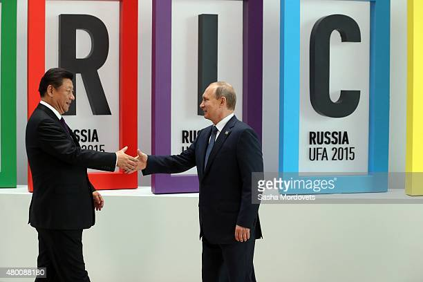 Chinese President Xi Jinping shake hands with Russian President Vladimir Putin during the BRICS 2015 Summit in Ufa Russia July2015 Leaders of China...