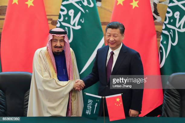 Chinese President Xi Jinping shake hands with Saudi Arabia's King Salman bin Abdulaziz Al Saud during a signing ceremony at the Great Hall of the...