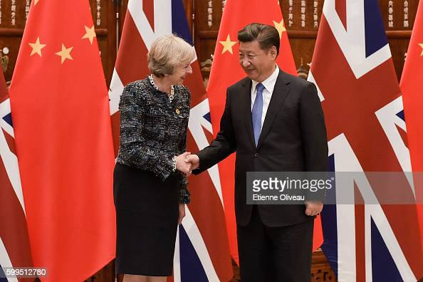 Chinese President Xi Jinping shakes hand with British Prime Minister Theresa May before their meeting at the West Lake State House on September 5...