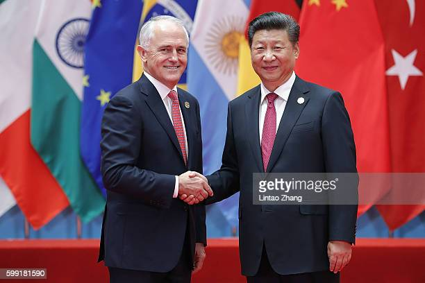 Chinese President Xi Jinping shakes hands with Australia's Prime Minister Malcolm Turnbull to the G20 Summit at the Hangzhou International Expo...