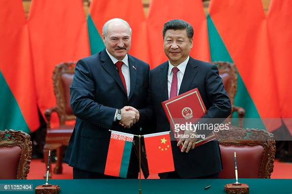 Chinese President Xi Jinping shakes hands with Belarusian President Alexander Lukashenko during a signing ceremony at the Great Hall of the People on...