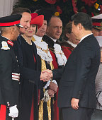 Chinese President Xi Jinping shakes hands with British Prime Minister David Cameron as they attend the Official Ceremonial Welcome for the Chinese...