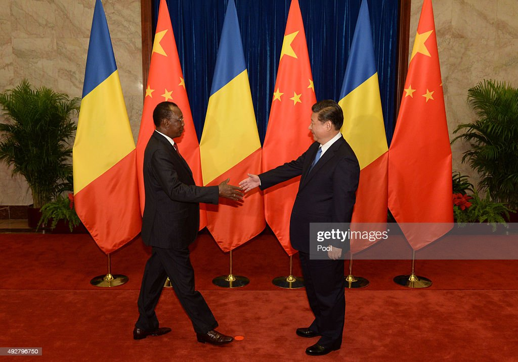 Chinese President <a gi-track='captionPersonalityLinkClicked' href=/galleries/search?phrase=Xi+Jinping&family=editorial&specificpeople=2598986 ng-click='$event.stopPropagation()'>Xi Jinping</a> (right), shakes hands with Chad's President Idriss Deby before their meeting at the Great Hall of the People on October 15, 2015 in Beijing, China.