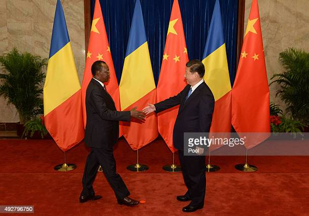 Chinese President Xi Jinping shakes hands with Chad's President Idriss Deby before their meeting at the Great Hall of the People on October 15 2015...