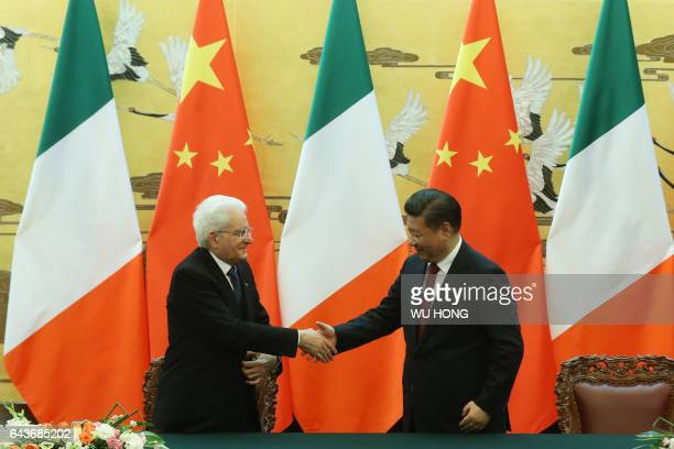 Chinese President Xi Jinping shakes hands with Italian President Sergio Mattarella during a signing ceremony at the Great Hall of the People in...