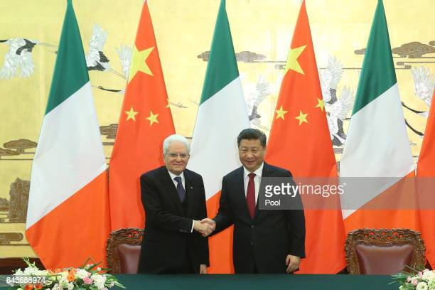 Chinese President Xi Jinping shakes hands with Italian President Sergio Mattarella during a signing ceremony at the Great Hall of the People on 22nd...