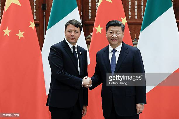 Chinese President Xi Jinping shakes hands with Italian Prime Minister Matteo Renzi before during their meeting at the West lake State Guest House on...