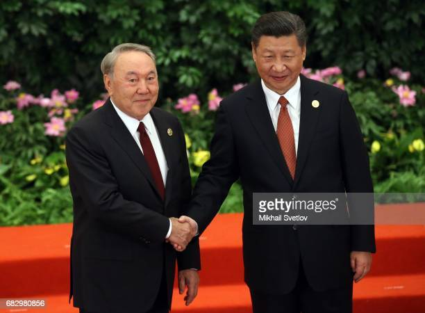 Chinese President Xi Jinping shakes hands with Kazakh President Nursultan Nazarbayev prior to the dinner during the Belt and Road Forum for...