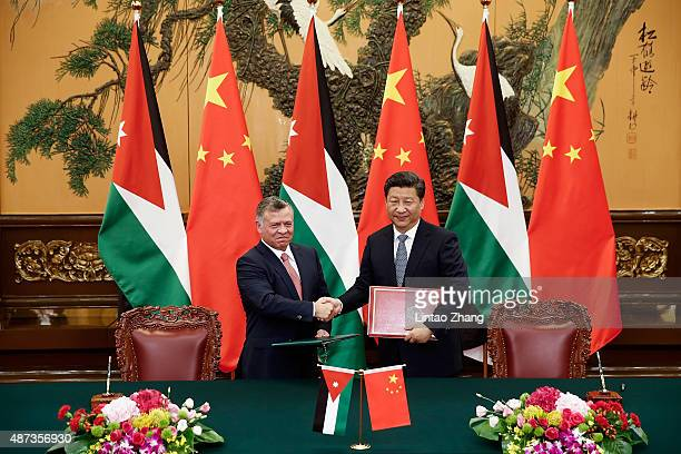 Chinese President Xi Jinping shakes hands with King of Jordan Abdullah II during a signing ceremony at The Great Hall Of The People on September 9...