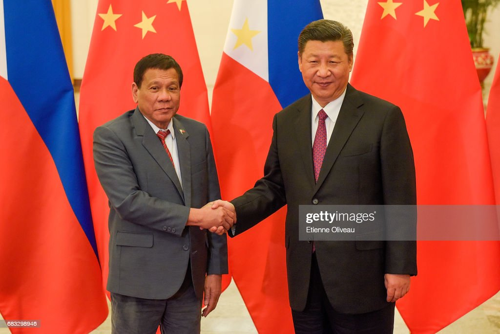 Chinese President Xi Jinping (R) shakes hands with Philippines President Rodrigo Duterte (L) prior to their bilateral meeting during the Belt and Road Forum for International Cooperation at the Great Hall of the People on May 15, 2017 in Beijing, China.