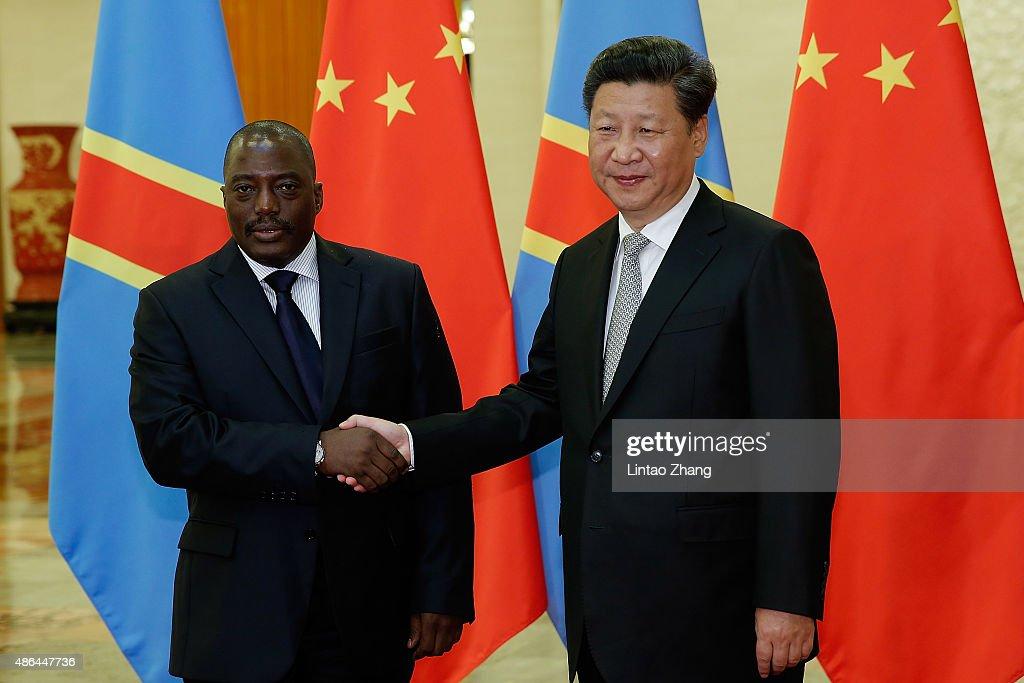 Chinese President <a gi-track='captionPersonalityLinkClicked' href=/galleries/search?phrase=Xi+Jinping&family=editorial&specificpeople=2598986 ng-click='$event.stopPropagation()'>Xi Jinping</a> (R) shakes hands with President Of Democratic Republic Of The Congo <a gi-track='captionPersonalityLinkClicked' href=/galleries/search?phrase=Joseph+Kabila&family=editorial&specificpeople=467567 ng-click='$event.stopPropagation()'>Joseph Kabila</a> (L) at The Great Hall Of The People on September 4, 2015 in Beijing, China. <a gi-track='captionPersonalityLinkClicked' href=/galleries/search?phrase=Joseph+Kabila&family=editorial&specificpeople=467567 ng-click='$event.stopPropagation()'>Joseph Kabila</a> has arrived in China to participate in the commemorative activities of the 70th anniversary of the victory of the Chinese Peoples's War of Resisitance against Japanese aggression and World War II.