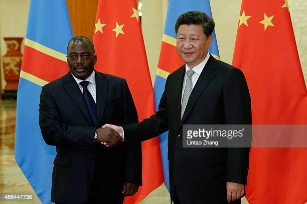 Chinese President Xi Jinping shakes hands with President Of Democratic Republic Of The Congo Joseph Kabila at The Great Hall Of The People on...