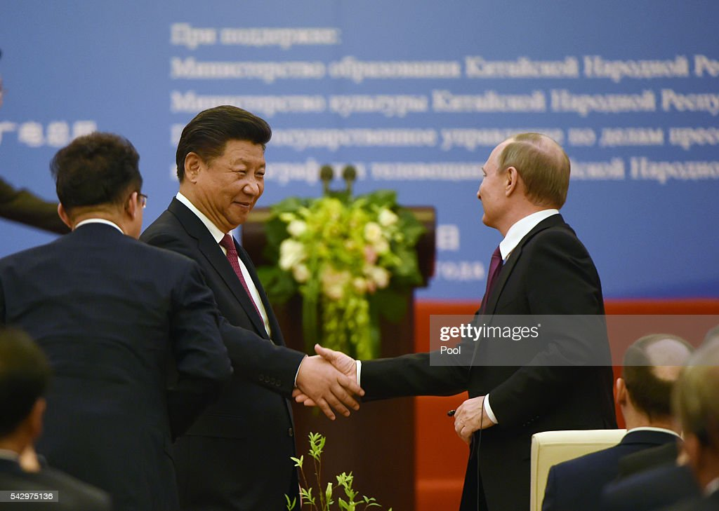 Chinese President Xi Jinping (L) shakes hands with Russian President Vladimir Putin during a ceremony marking the 15th anniversary of the signing of the China-Russia Treaty on Good neighborliness, Friendship and Cooperation, in Beijing's Great Hall of the People on June 25, 2016 in Beijing, China. Russian President Vladimir Putin is in China to discuss more economic and military cooperation between the two countries.