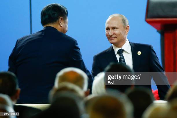 Chinese President Xi Jinping shakes hands with Russian President Vladimir Putin during the opening ceremony of the Belt and Road Forum on May 14 2017...