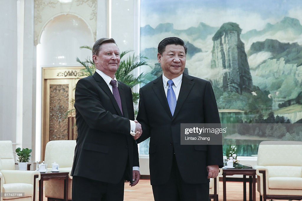 Chinese President Xi Jinping shakes hands with Russian Presidential Chief of Staff Sergei Ivanov at The Great Hall Of The People on March 25 2016 in...