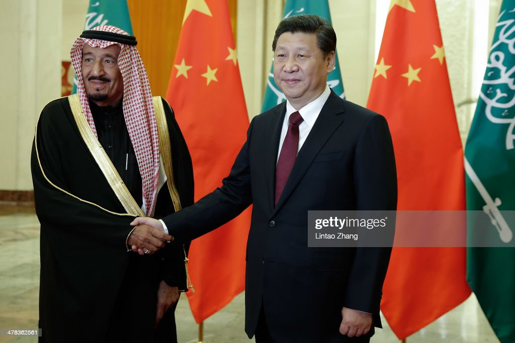 Chinese President <a gi-track='captionPersonalityLinkClicked' href=/galleries/search?phrase=Xi+Jinping&family=editorial&specificpeople=2598986 ng-click='$event.stopPropagation()'>Xi Jinping</a> (R) shakes hands with Saudi Crown Prince Salman bin Abdulaziz (L) after a welcoming ceremony at the Great Hall of the People on March 13, 2014 in Beijing, China. Saudi Crown Prince Salman bin Abdulaziz will pay a four-day state visit to China from March 13 to 16.