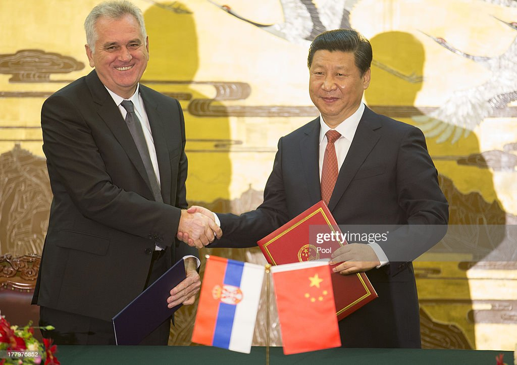 Chinese President <a gi-track='captionPersonalityLinkClicked' href=/galleries/search?phrase=Xi+Jinping&family=editorial&specificpeople=2598986 ng-click='$event.stopPropagation()'>Xi Jinping</a> (R) shakes hands with Serbian President Tomislav Nicolick at a signing ceremony at the Great Hall of the People in Beijing 26 August 2013. Nicolic is on a five day visit to China to bolster economic and diplomatic ties.