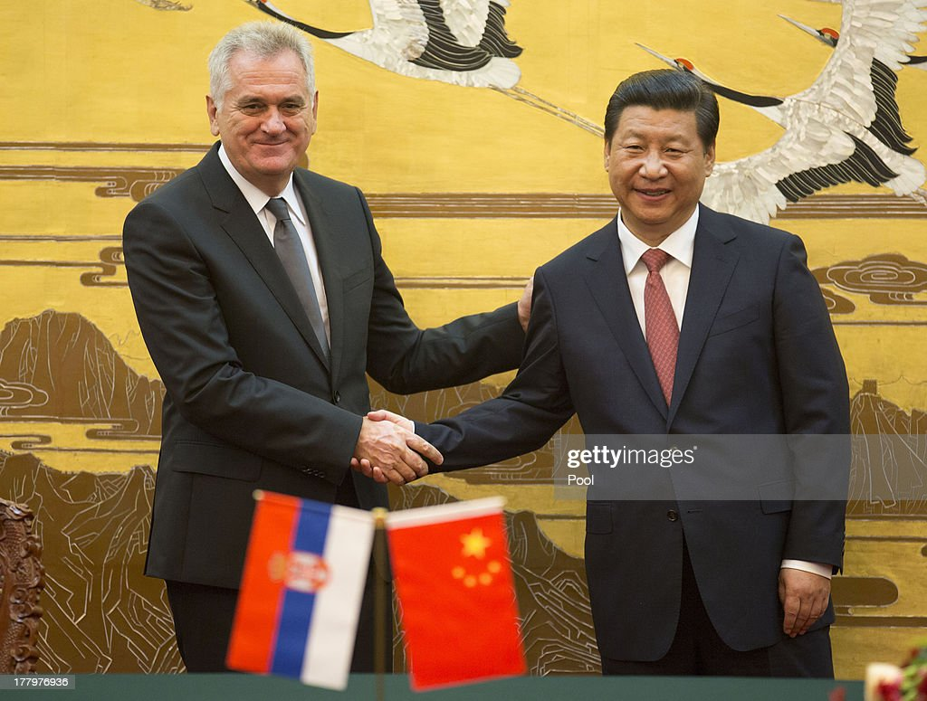Chinese President Xi Jinping (R) shakes hands with Serbian President Tomislav Nicolick at a signing ceremony at the Great Hall of the People in Beijing 26 August 2013. Nicolic is on a five day visit to China to bolster economic and diplomatic ties.