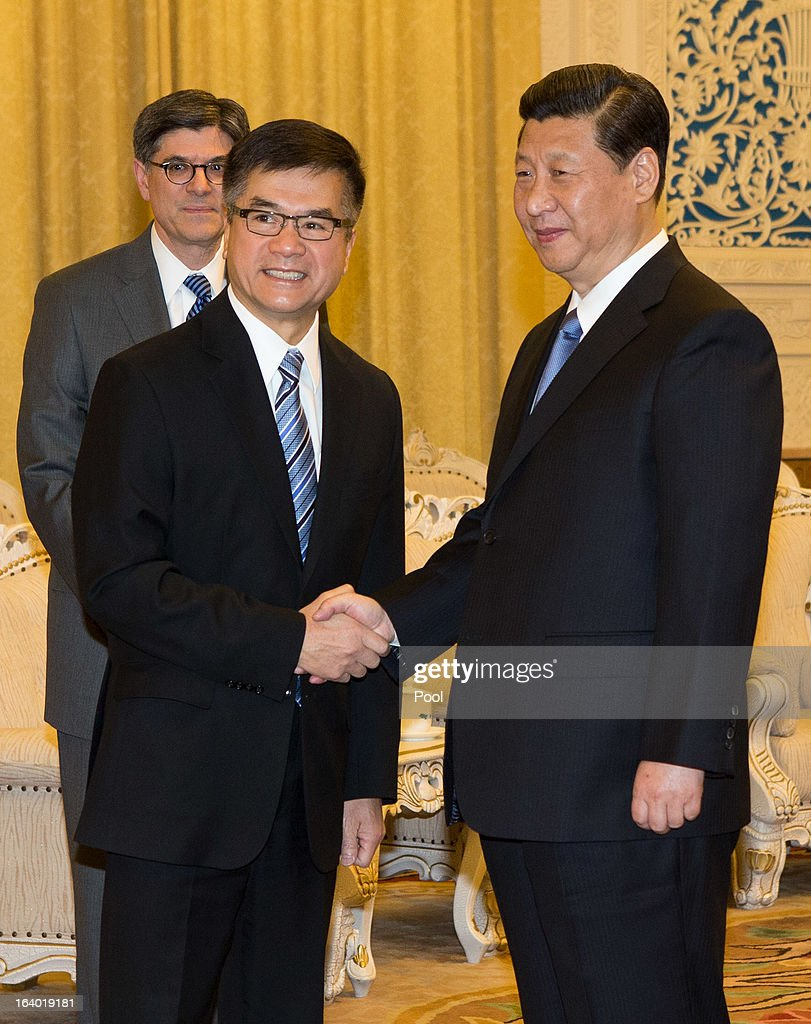 Chinese President <a gi-track='captionPersonalityLinkClicked' href=/galleries/search?phrase=Xi+Jinping&family=editorial&specificpeople=2598986 ng-click='$event.stopPropagation()'>Xi Jinping</a> (R) shakes hands with shakes hand with U.S. Ambassador to China Gary Lock as U.S. Secretary of Treasury Jacob Lew looks on during his visit to the Great Hall of the People on March 19, 2013 in Beijing, China. Chinese leader <a gi-track='captionPersonalityLinkClicked' href=/galleries/search?phrase=Xi+Jinping&family=editorial&specificpeople=2598986 ng-click='$event.stopPropagation()'>Xi Jinping</a> spoke of wanting strong ties with the U.S. after holding talks with the US Treasury secretary Jacob Lew today in his first meeting with a foreign official since being appointed as president.