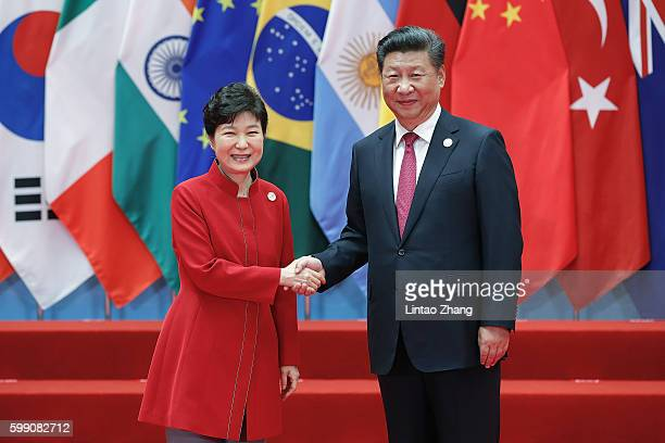 Chinese President Xi Jinping shakes hands with South Korean President Park GeunHye to the G20 Summit at the Hangzhou International Expo Center on...
