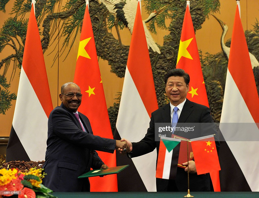 Chinese President <a gi-track='captionPersonalityLinkClicked' href=/galleries/search?phrase=Xi+Jinping&family=editorial&specificpeople=2598986 ng-click='$event.stopPropagation()'>Xi Jinping</a> (R) shakes hands with Sudanese President <a gi-track='captionPersonalityLinkClicked' href=/galleries/search?phrase=Omar+al-Bashir&family=editorial&specificpeople=588924 ng-click='$event.stopPropagation()'>Omar al-Bashir</a> during a signing ceremony at the Great Hall of the People on September 1, 2015 in Beijing, China. The Sudanese President is on a four-day visit to China, despite facing two international arrest warrents issued by the International Criminal Court (ICC) for alleged war crimes. Bashir will also attend China's V-Day celebrations during his visit.