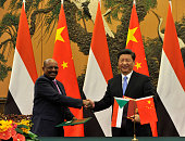 Chinese President Xi Jinping shakes hands with Sudanese President Omar alBashir during a signing ceremony at the Great Hall of the People on...
