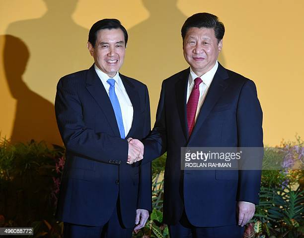 Chinese President Xi Jinping shakes hands with Taiwan President Ma Yingjeou before their meeting at Shangrila hotel in Singapore on November 7 2015...