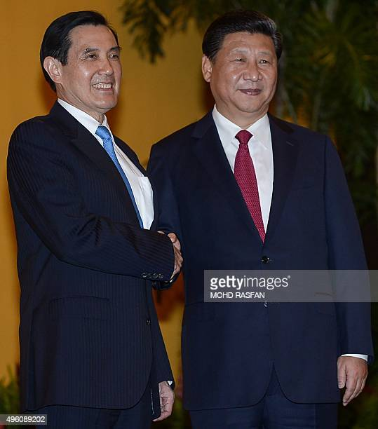 Chinese President Xi Jinping shakes hands with Taiwan President Ma Yingjeou before a meeting at Shangrila hotel in Singapore on November 7 2015 The...
