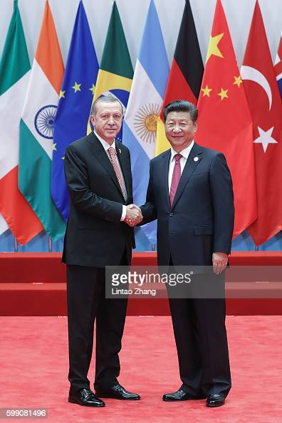 Chinese President Xi Jinping shakes hands with Turkish President Recep Tayyip Erdogan to the G20 Summit at the Hangzhou International Expo Center on...