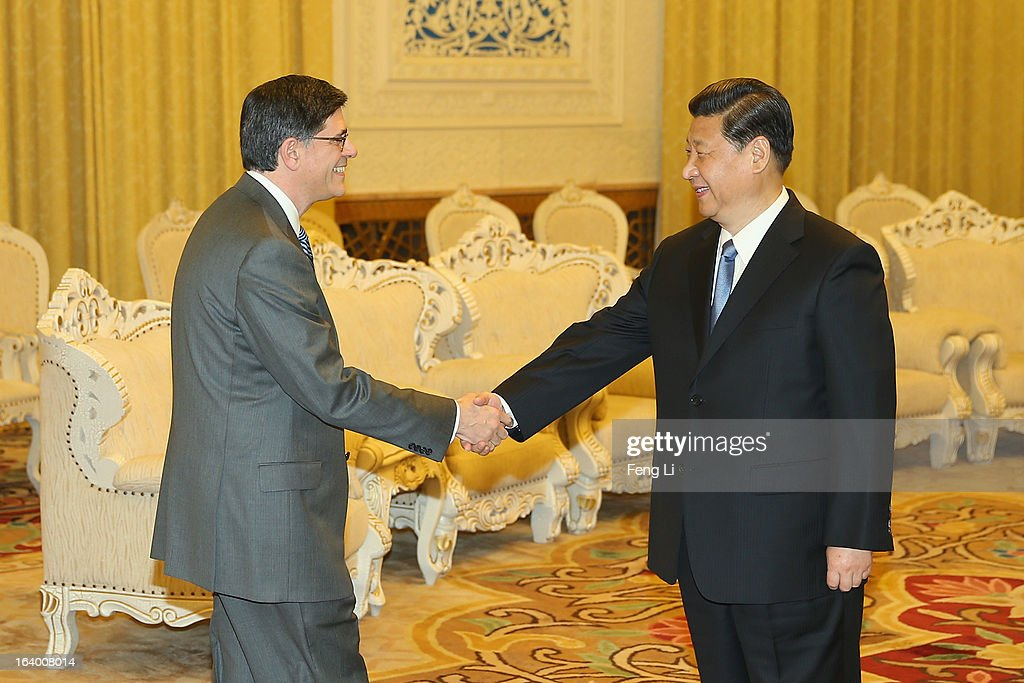 Chinese President <a gi-track='captionPersonalityLinkClicked' href=/galleries/search?phrase=Xi+Jinping&family=editorial&specificpeople=2598986 ng-click='$event.stopPropagation()'>Xi Jinping</a> (R) shakes hands with U.S. Secretary of Treasury Jacob Lew (L) during his visit to the Great Hall of the People on March 19, 2013 in Beijing, China. Chinese leader <a gi-track='captionPersonalityLinkClicked' href=/galleries/search?phrase=Xi+Jinping&family=editorial&specificpeople=2598986 ng-click='$event.stopPropagation()'>Xi Jinping</a> spoke of wanting strong ties with the U.S. after holding talks with the US Treasury secretary Jacob Lew today in his first meeting with a foreign official since being appointed as president.