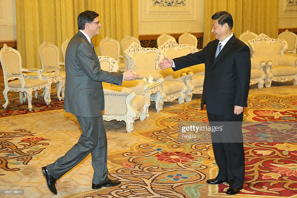 Chinese President <a gi-track='captionPersonalityLinkClicked' href=/galleries/search?phrase=Xi+Jinping&family=editorial&specificpeople=2598986 ng-click='$event.stopPropagation()'>Xi Jinping</a> (R) shakes hands with U.S. Secretary of Treasury Jacob Lew (L) during his visit to the Great Hall of the People on March 19, 2013 in Beijing, China.