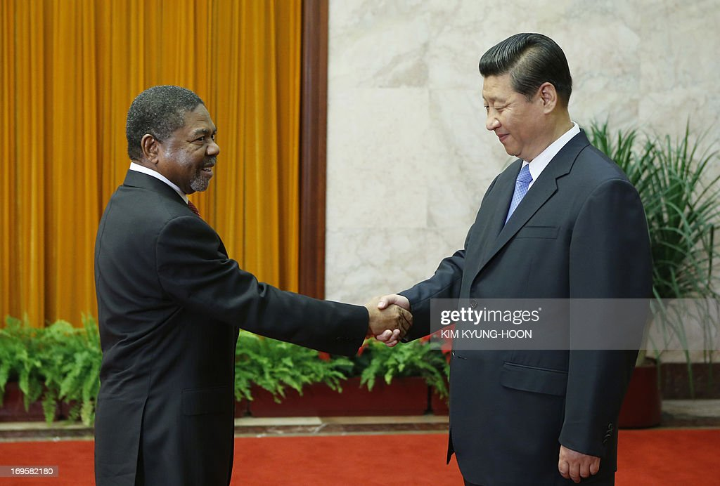 Chinese President Xi Jinping (R) shakes hands with Zanzibar's President Ali Mohamed Shein during a meeting at the Great Hall of the People in Beijing on May 28, 2013. AFP PHOTO / POOL
