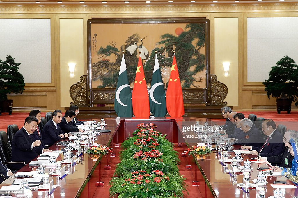Chinese President <a gi-track='captionPersonalityLinkClicked' href=/galleries/search?phrase=Xi+Jinping&family=editorial&specificpeople=2598986 ng-click='$event.stopPropagation()'>Xi Jinping</a> (L) shankes hands with Pakistan President <a gi-track='captionPersonalityLinkClicked' href=/galleries/search?phrase=Mamnoon+Hussain&family=editorial&specificpeople=11183703 ng-click='$event.stopPropagation()'>Mamnoon Hussain</a> (3nd-R) at The Great Hall Of The People on September 2, 2015 in Beijing, China. Pakistan President <a gi-track='captionPersonalityLinkClicked' href=/galleries/search?phrase=Mamnoon+Hussain&family=editorial&specificpeople=11183703 ng-click='$event.stopPropagation()'>Mamnoon Hussain</a> will attend the Chinese People's Anti-Japanese War and the World Anti-Fascist War 70th anniversary victory parade on September 3.