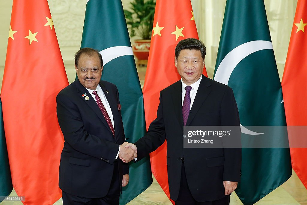Chinese President <a gi-track='captionPersonalityLinkClicked' href=/galleries/search?phrase=Xi+Jinping&family=editorial&specificpeople=2598986 ng-click='$event.stopPropagation()'>Xi Jinping</a> (R) shankes hands with Pakistan President <a gi-track='captionPersonalityLinkClicked' href=/galleries/search?phrase=Mamnoon+Hussain&family=editorial&specificpeople=11183703 ng-click='$event.stopPropagation()'>Mamnoon Hussain</a> (L) at The Great Hall Of The People on September 2, 2015 in Beijing, China. Pakistan President <a gi-track='captionPersonalityLinkClicked' href=/galleries/search?phrase=Mamnoon+Hussain&family=editorial&specificpeople=11183703 ng-click='$event.stopPropagation()'>Mamnoon Hussain</a> will attend the Chinese People's Anti-Japanese War and the World Anti-Fascist War 70th anniversary victory parade on September 3.