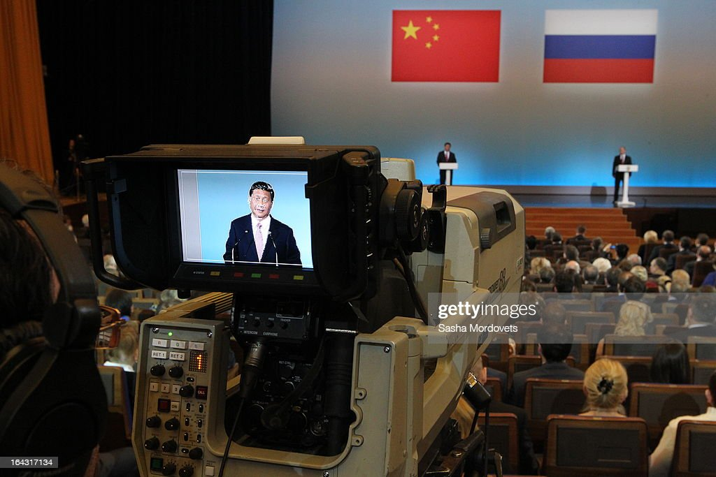 Chinese President <a gi-track='captionPersonalityLinkClicked' href=/galleries/search?phrase=Xi+Jinping&family=editorial&specificpeople=2598986 ng-click='$event.stopPropagation()'>Xi Jinping</a> (L) si sen on a monitor speaking during a concert in the Kremlin on March 22, 2013 in Moscow, Russia. President <a gi-track='captionPersonalityLinkClicked' href=/galleries/search?phrase=Xi+Jinping&family=editorial&specificpeople=2598986 ng-click='$event.stopPropagation()'>Xi Jinping</a>'s visit to Russia is his first overseas trip as president.