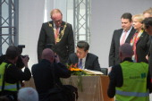 Chinese President Xi Jinping signs the 'Golden Book' of the city of Duisburg next to Lord Mayor of the city of Duisburg Soren Link on March 29 2014...