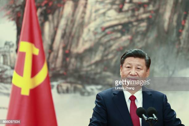 Chinese President Xi Jinping speaks at the podium during the unveiling of the Communist Party's new Politburo Standing Committee at the Great Hall of...