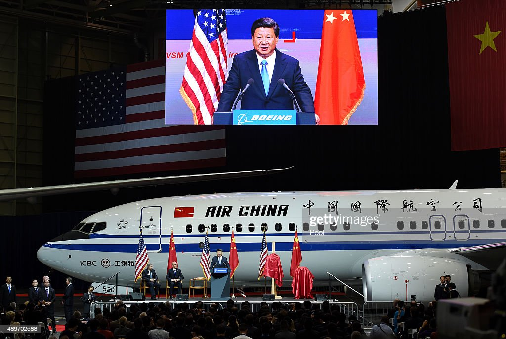 Chinese President Xi Jinping speaks beside Ray Conner President and CEO of the Boeing Commercial Airplanes and Dennis Muilenburg President and CEO of...