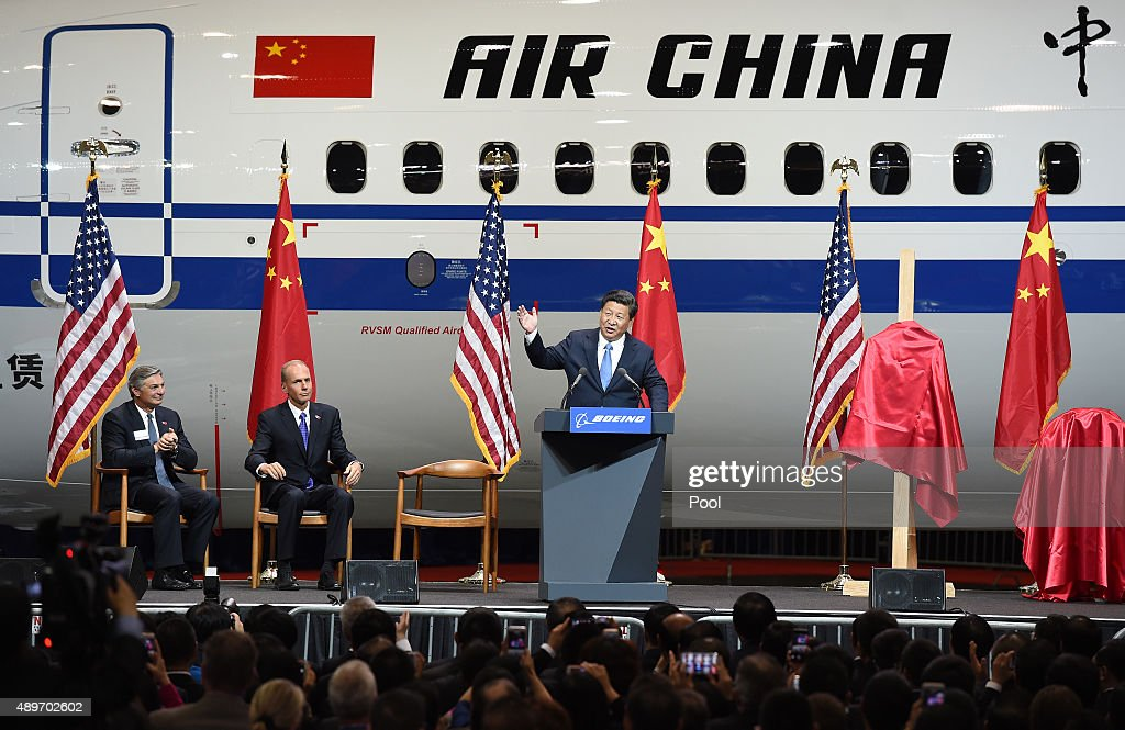 Chinese President <a gi-track='captionPersonalityLinkClicked' href=/galleries/search?phrase=Xi+Jinping&family=editorial&specificpeople=2598986 ng-click='$event.stopPropagation()'>Xi Jinping</a> (R) speaks beside <a gi-track='captionPersonalityLinkClicked' href=/galleries/search?phrase=Ray+Conner&family=editorial&specificpeople=7660065 ng-click='$event.stopPropagation()'>Ray Conner</a> (L), President and CEO of the Boeing Commercial Airplanes and <a gi-track='captionPersonalityLinkClicked' href=/galleries/search?phrase=Dennis+Muilenburg&family=editorial&specificpeople=6560068 ng-click='$event.stopPropagation()'>Dennis Muilenburg</a> (2nd L), President and CEO of the Boeing Company, after his tour of the Boeing assembly line on September 23, 2015, in Seattle, Washington. According to state media and it's local partner, Boeing has reached deals with Chinese firms to sell 300 aircraft and set up a completion center in China, as President <a gi-track='captionPersonalityLinkClicked' href=/galleries/search?phrase=Xi+Jinping&family=editorial&specificpeople=2598986 ng-click='$event.stopPropagation()'>Xi Jinping</a> continues his state visit to the United States.