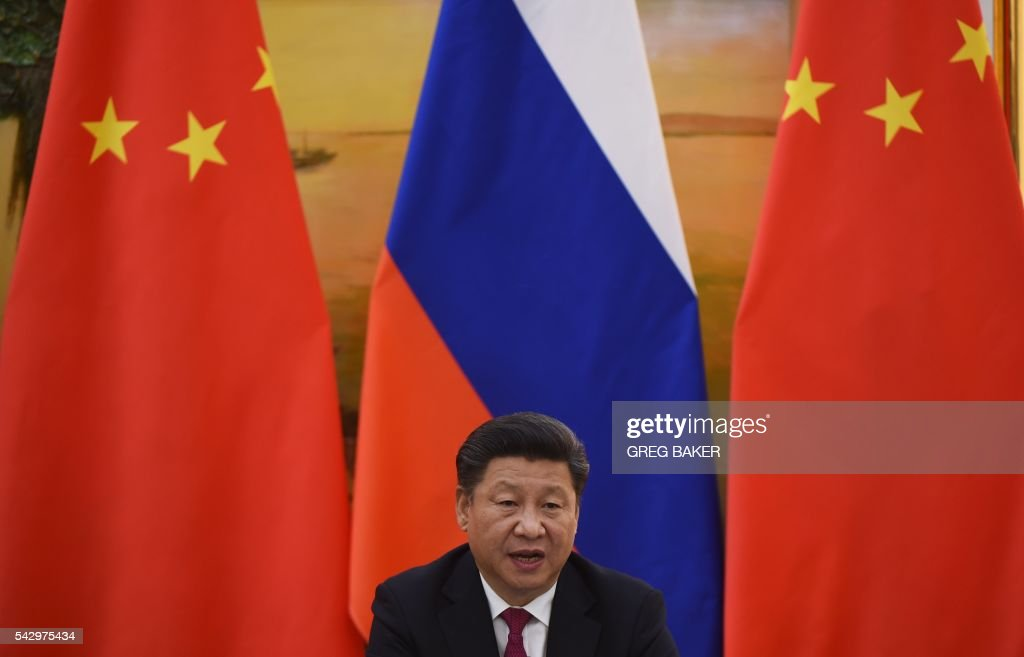Chinese President Xi Jinping speaks during a joint press briefing with Russian President Vladimir Putin, in Beijing's Great Hall of the People on June 25, 2016. / AFP / POOL / GREG