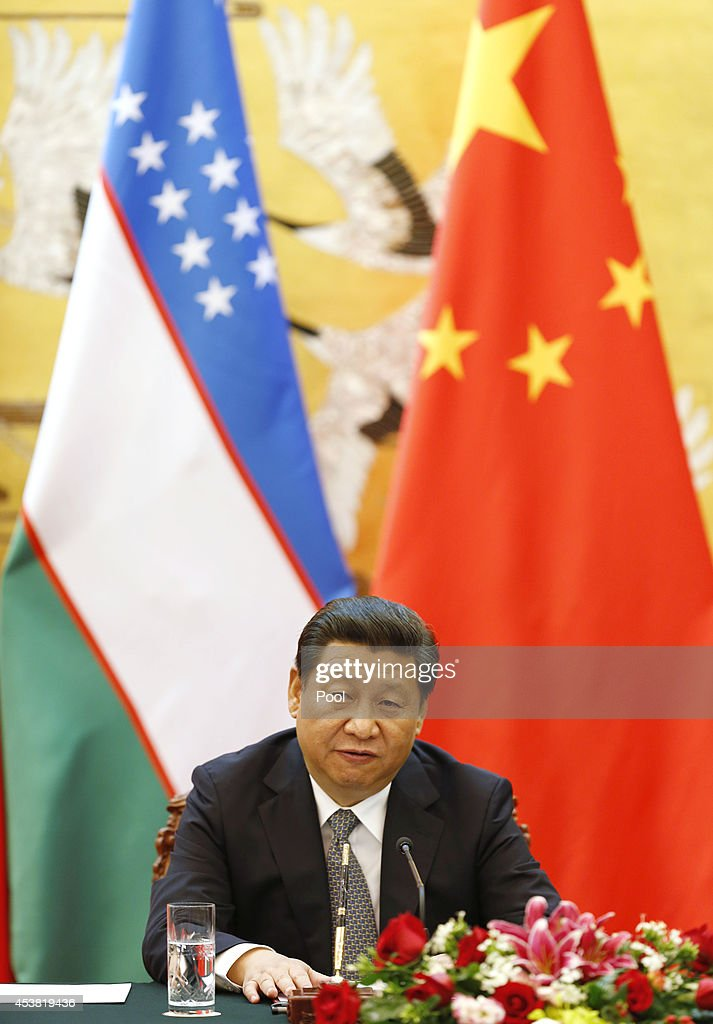 Chinese President <a gi-track='captionPersonalityLinkClicked' href=/galleries/search?phrase=Xi+Jinping&family=editorial&specificpeople=2598986 ng-click='$event.stopPropagation()'>Xi Jinping</a> speaks during a press conference with Uzbekistan's President Islam Karimov on August 19, 2014 at the Great Hall of the People in Beijing, China.